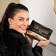 Etui de maquillage GNTM en noir-or