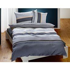 Linge de lit à rayures et à pois dans différents tons de gris