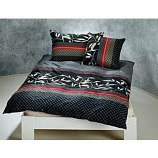 Linge de lit avec motif de feuilles sur fond noir rayé