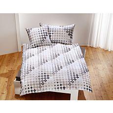 Linge de lit blanc à motif de carreaux en tons gris clair et sable