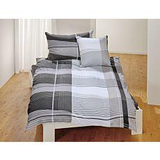 Linge de lit à rayures dans les tons blanc et gris