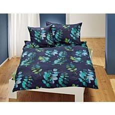 Linge de lit avec motif de feuilles sur fond bleu foncé