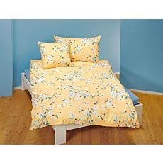 Linge de lit agrémenté d'un magnifique motif floral sur fond jaune pâle
