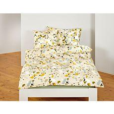 Linge de lit orné de taches colorées