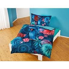 Linge de lit orné d'oiseaux de paradis bleus et de fleurs