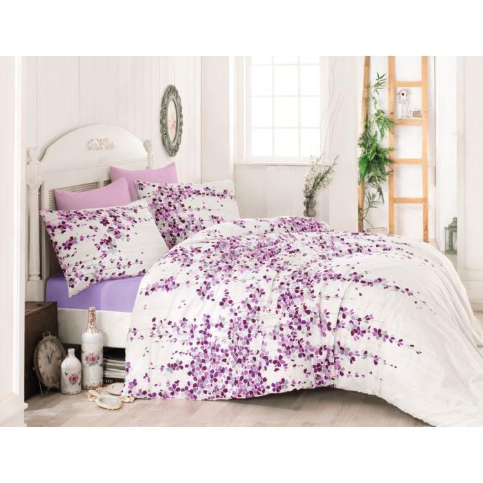 Linge de lit avec motif fleuri sur fond blanc