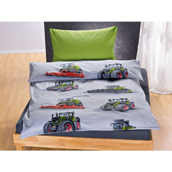 Parure de lit avec machines agricoles sur fond blanc