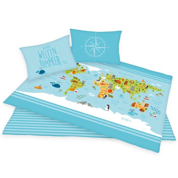 Linge de lit avec carte du monde multicolore sur fond bleu clair