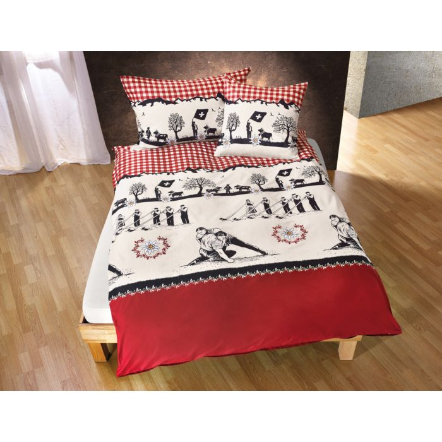 Linge de lit avec motifs traditionnels d'une fête de lutte en rouge, noir et beige