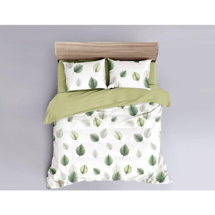 Linge de lit blanc agrémenté de feuilles vertes