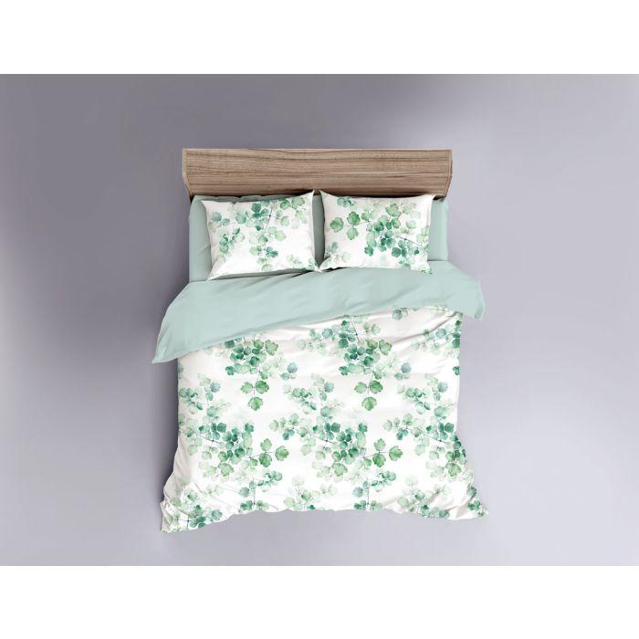 Linge de lit orné de feuilles dans divers tons de vert